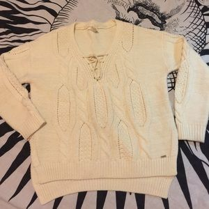 Cable knit lace up sweater